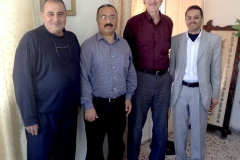 From left, GCMHP staff: Yousef Ghazaly, Husam Al Nounu, GMHF President Bill Slaughter, and GCMHP Executive Director Yasser Abu Jamei
