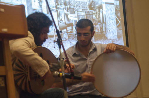 Kinan Idnawi (oud) and Tareq Rantisi (percussion) accompany a slide presentation of images of Israel's summer attack on Gaza.