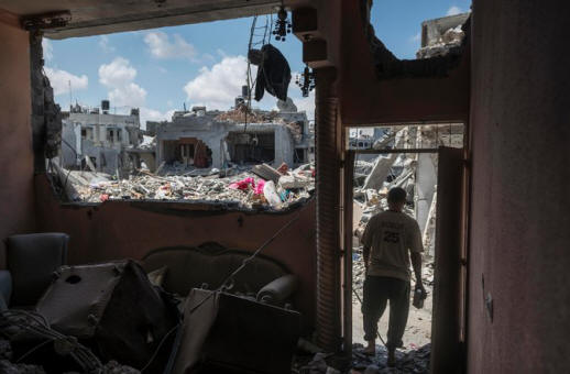 A Palestinian man surveyed his devastated neighborhood Monday from the doorway of his destroyed home in Beit Hanoun, Gaza. Credit Sergey Ponomarev for The New York Times