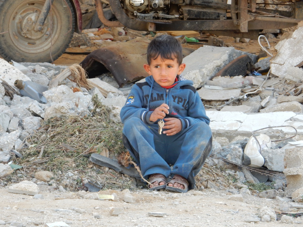 Gaza boy in rubble from Israeli invasion of 2014